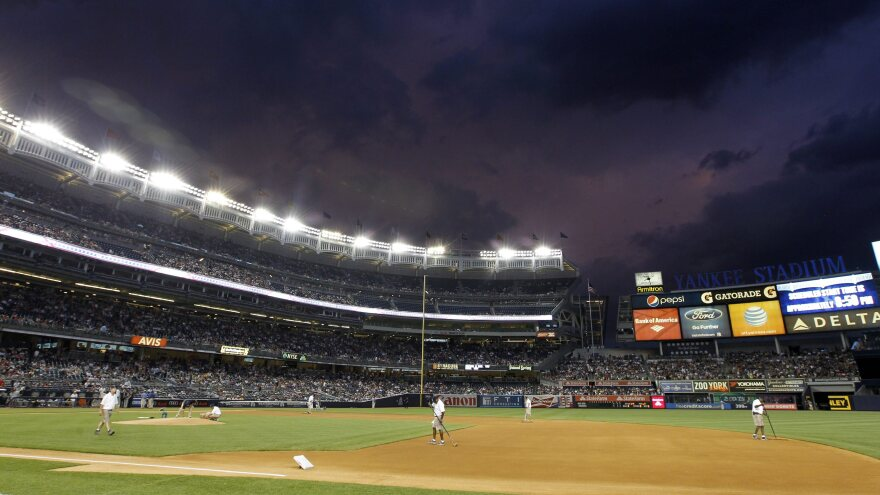 Dark clouds hang over Major League Baseball. There are reports that about 20 players may be suspended because of their connections to a Miami clinic that dispensed performance-enhancing drugs. (Photo taken Sunday at Yankee Stadium.)