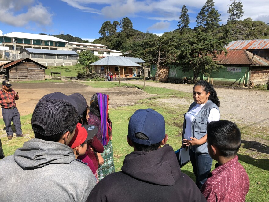 Lesbya Espinal, a volunteer from the U.S. sponsored group, Association of Returned Guatemalans, talking to young people in town.