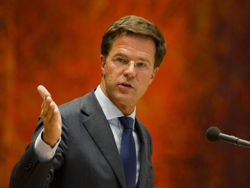 Dutch Prime Minister Mark Rutte, shown here speaking in Parliament on Tuesday, resigned a day earlier over a budget crisis.
