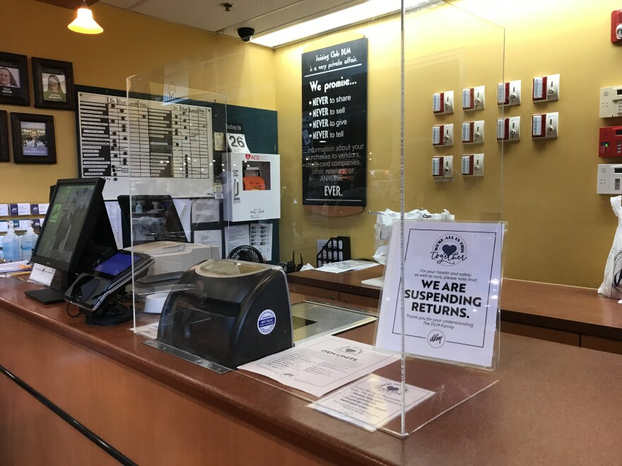 A cash register at Dorothy Lane Market's Springboro Store has a sneeze guard to protect workers and customers during the coronavirus pandemic. The company has hired local restaurant workers who were recently laid off.