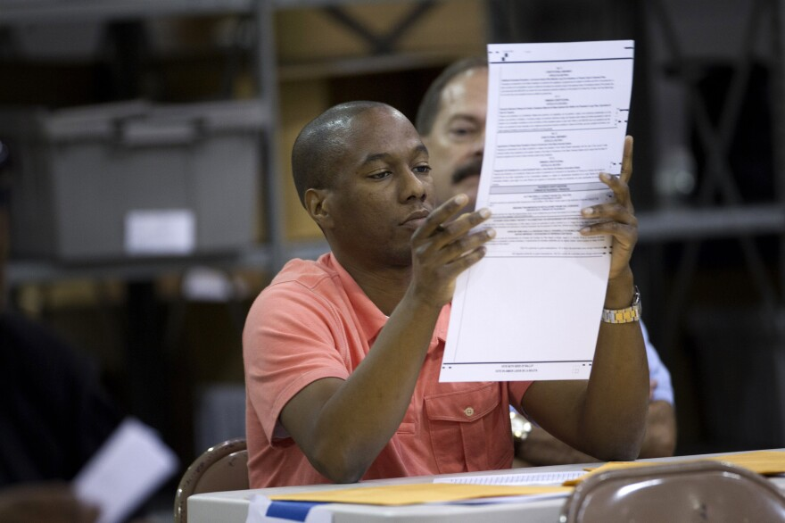 A Palm Beach County election worker counts ballots in Riviera Beach, Fla., on Nov. 9. Rep. Allen West contested the results of the election in Florida's 18th District for two weeks before conceding. Since 2000, the number of contested elections has more than doubled.