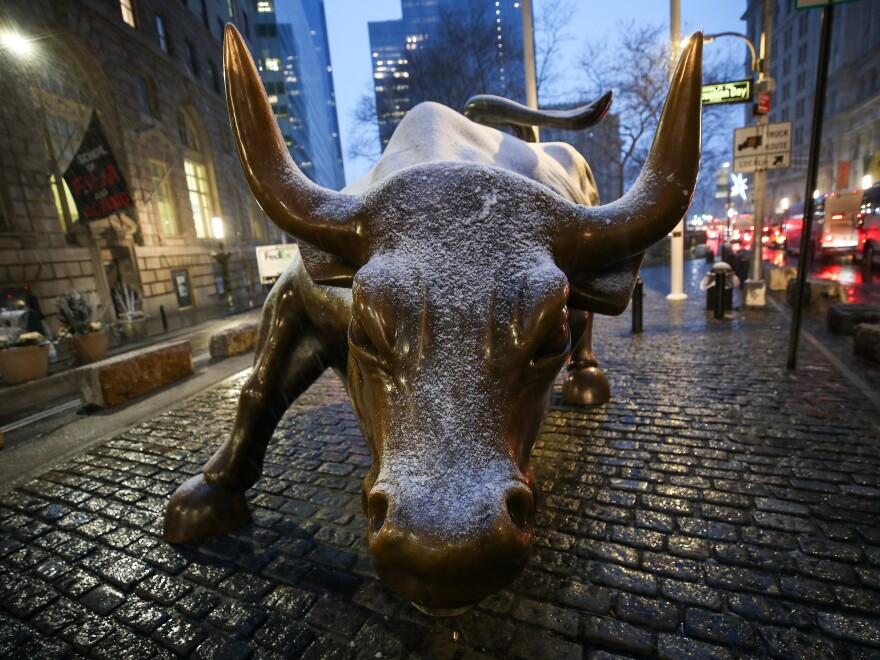 The Charging Bull Statue is seen at the Financial District as snow falls in New York City on Dec. 16. The SPAC, or Special Purpose Acquisition Company, has become the hottest trend in Wall Street this year. It allows a company to go public without all the paperwork of a traditional IPO.