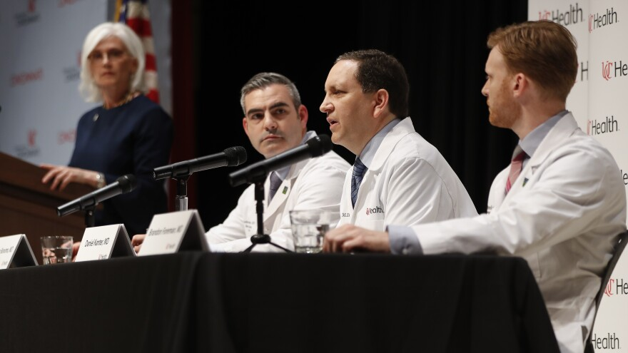 """Daniel Kanter (center right), medical director of the neurocritical care program in Cincinnati, speaks to reporters alongside doctors Jordan Bonomo and Brandon Foreman on Thursday. They say released U.S. student Otto Warmbier is in a state """"best described as unresponsive wakefulness."""""""