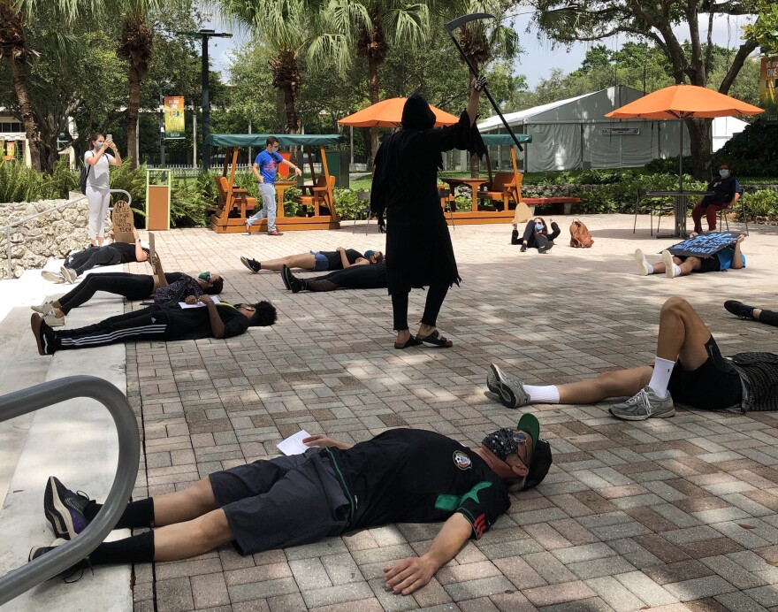 "University of Miami students and employees hold a ""die-in"" at the Coral Gables campus on Sept. 4, 2020. Demonstrators were protesting subcontracted employees' working conditions, among other grievances."