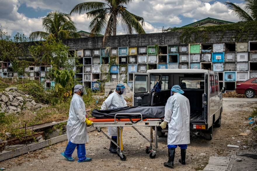 On April 3, funeral workers in protective suits unloaded the body of a person presumed to have died of the coronavirus, to be cremated at a public cemetery in Manila.
