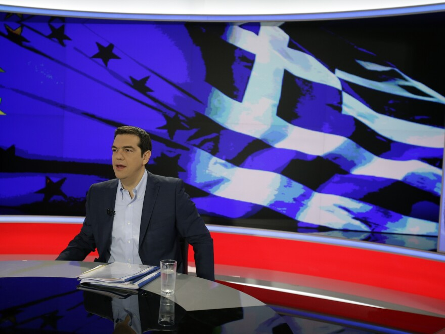 "Greece's Prime Minister Alexis Tsipras prepares for a TV interview at the State Television in Athens on Monday. He urged Greeks to vote ""no"" in Sunday's referendum on the terms of a bailout."
