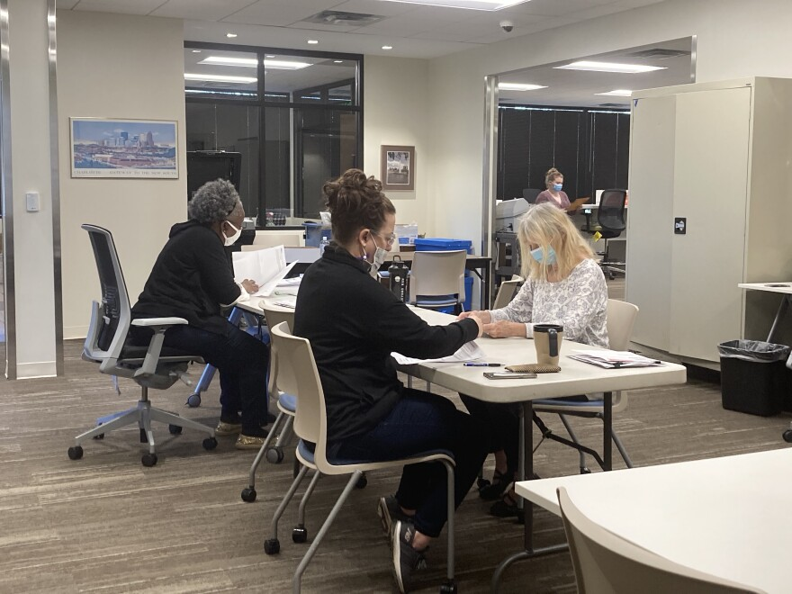 Mecklenburg County election workers at a table in the office
