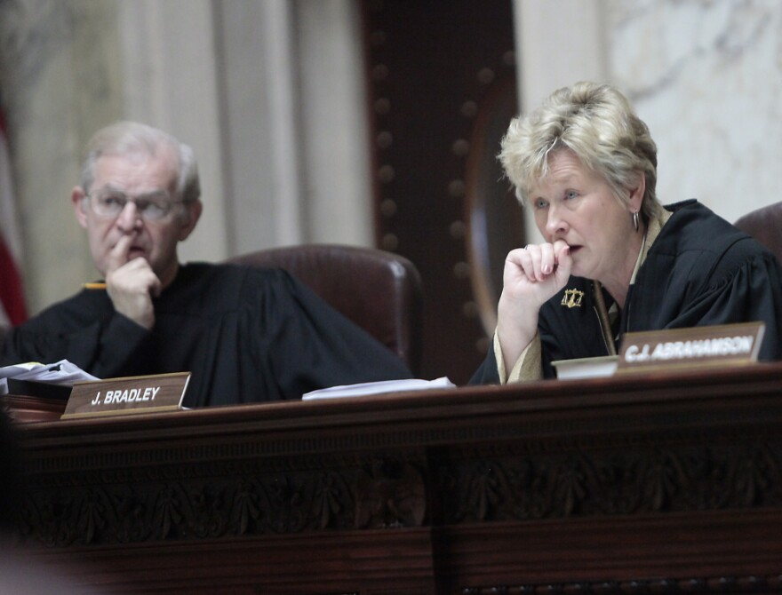 Wisconsin Supreme Court Justices David T. Prosser, Jr. and Ann Walsh Bradley consider oral arguments during a hearing regarding the state's budget bill at the Wisconsin State Capitol, June 6, 2011.
