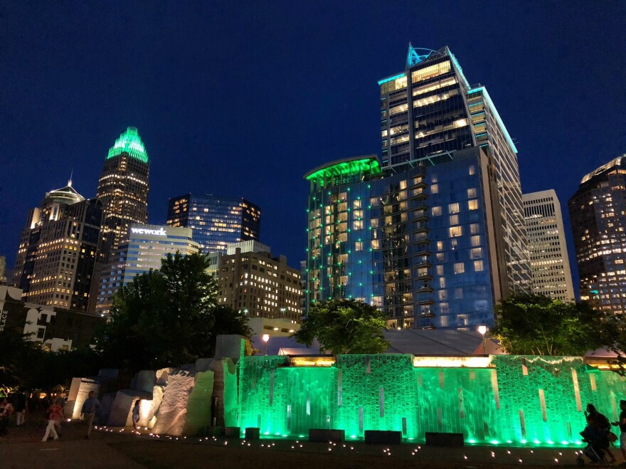 The Charlotte skyline illuminated green in 2019 to honor the victims of a shooting on the UNC Charlotte campus.