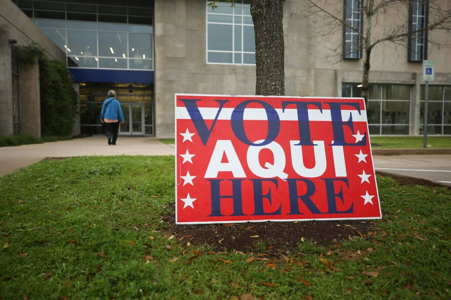 A voter enters a polling place at the North Austin YMCA on March 3, 2020.