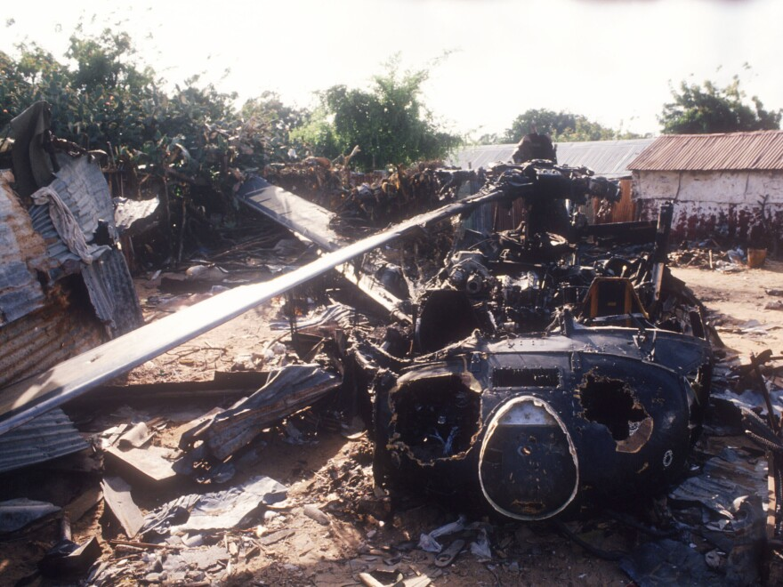 The wreckage of an American helicopter sits in Mogadishu, Somalia on Oct. 14, 1993. The events of the Battle of Mogadishu became a flashpoint for conversations about military interventions — and fodder for a big-budget Hollywood drama.