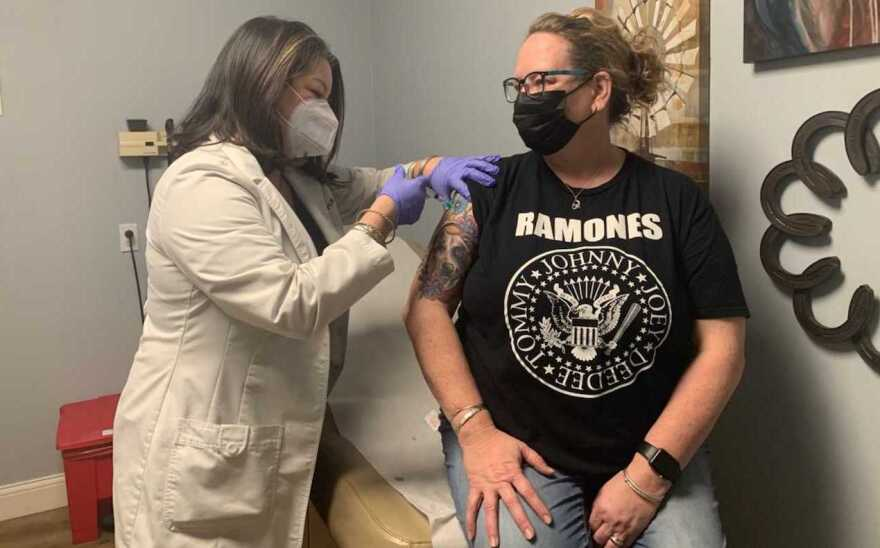Nurse Practitioner Natalie Bachynsky immunizing patient Dawn Lambright with the COVID-19 vaccine at her Houston County Family Medical Clinic in Crockett, Texas.