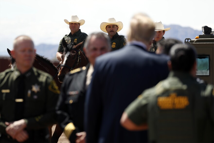 President Trump speaks as he visits a new section of the border wall with Mexico in Calexico, California, Friday April 5, 2019.