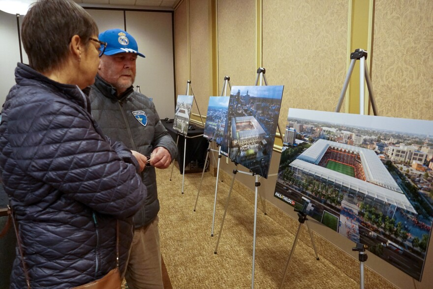 Robert and Chris Schnieders, from Creve Coeur, attended an open house Dec. 19 to learn more about the stadium construction project.