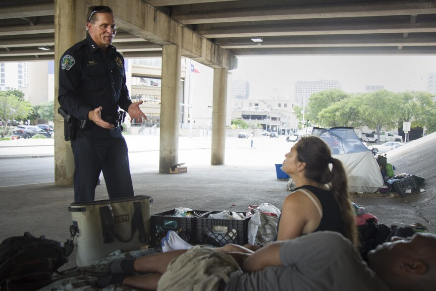 Assistant Austin Police Chief Justin Newsom speaks with Tanya Bullman and James McPherson