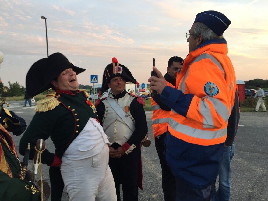 Napoleon, played by Paris lawyer Frank Samson, shares a moment with a Belgian traffic cop during Waterloo reenactment festivities.