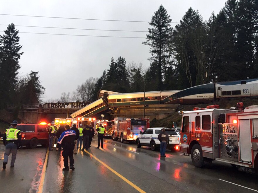 """An Amtrak train derailed south of Seattle and fell partly onto Interstate 5, where authorities initially reported """"injuries and casualties."""" Three deaths have have since been confirmed."""