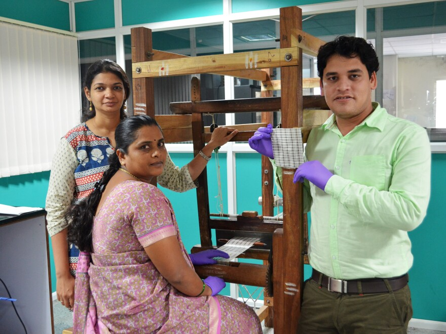 Sobha (center) is one of the weavers who turn silk into test strips. To her right is Tripurari Choudhary, a design engineer at Achira Labs. To her left is Mithila Azad, a company director.