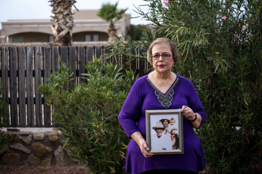 Arlinda Valencia, 68, holds a photograph taken in 1918 of her great-grandfather Longino Flores, left, great-grandmother Juana Bonilla Flores and aunt Rosa Flores Mesa.