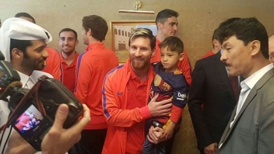 Lionel Messi's biggest fan, 6-year-old Murtaza Ahmady, met the soccer superstar Tuesday, months after wearing a homemade shirt mimicking the Argentine's jersey. They're seen here in Doha, Qatar, in a meeting arranged by the organizing committee of the 2022 World Cup.