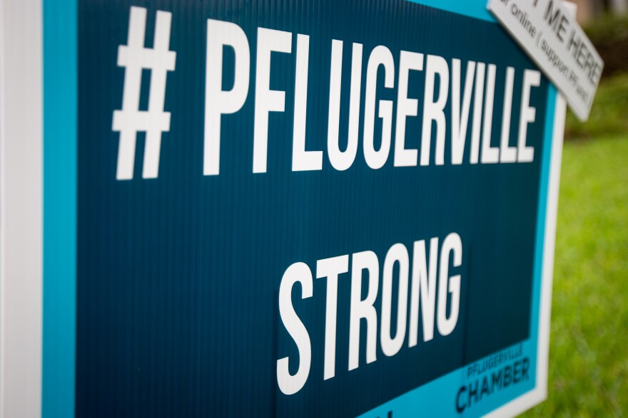 A sign in Pflugerville during the coronavirus pandemic. A Pflugerville high school is postponing its next two football games after a faculty member tested positive for COVID-19.