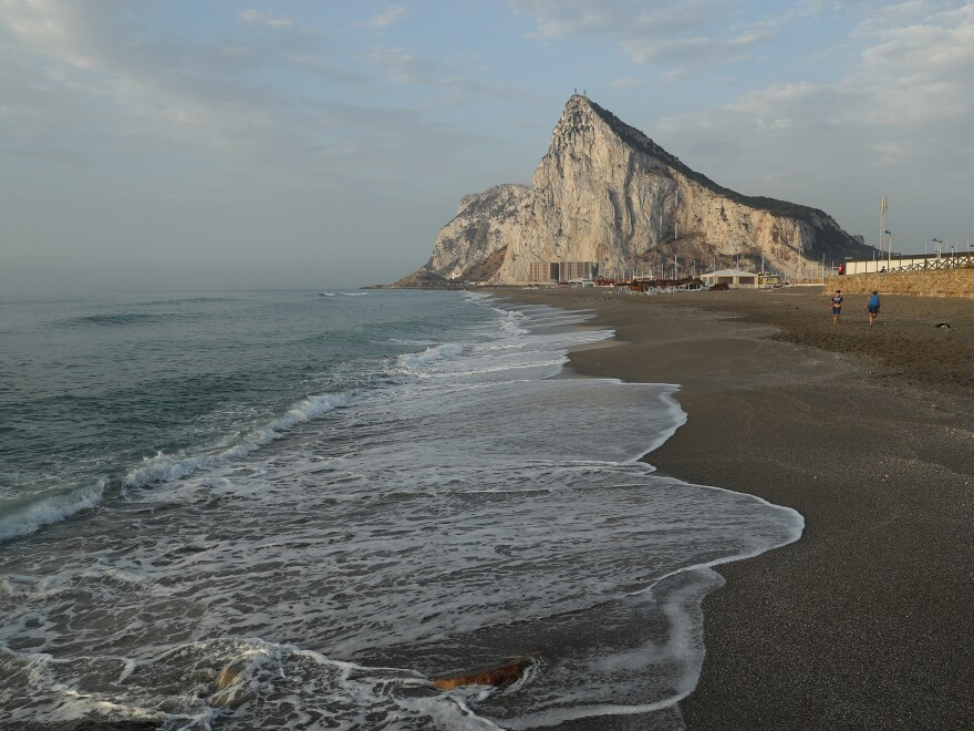 The limestone Rock of Gibraltar towers above the pensinsula, a British dependent territory that profits from tourism, finance and its shipyard.