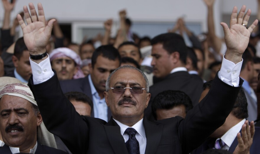 Yemeni President Ali Abdullah Saleh waves to supporters during a rally in Sanaa,Yemen, on April 15.