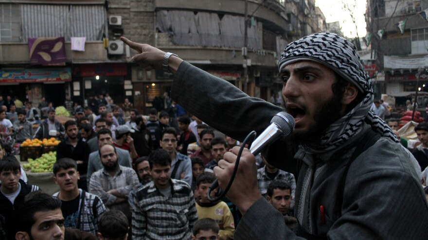 A member of the Islamic State of Iraq and the Levant urges Syrians in the city of Aleppo to fight against the Assad regime. This week, the militants apologized for beheading a commander from another anti-Assad group.