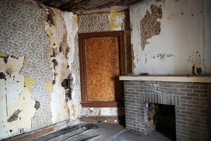 The nearly 130-year-old home, shown here in February, needed serious repairs. Volunteer crews and contractors updated the plumbing, electrical, heating systems to bring the home up to code.
