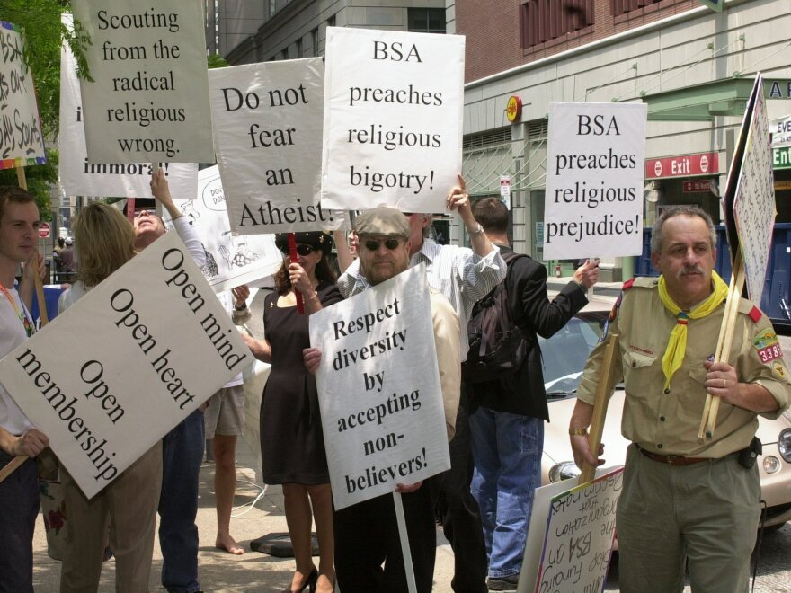 The Supreme Court upheld the Boy Scouts' right to discriminate in 2000, but the issue roiled for years after. Scott Cozza (right) leads a protest outside the National Council Conference of the Boy Scouts of America in Philadelphia in 2003.