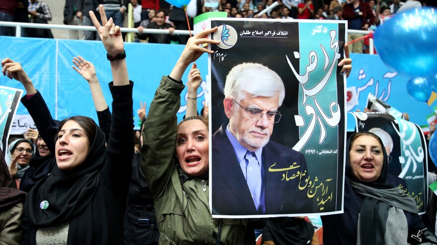 Iranian women chant support for Mohammad Reza Aref, a reformist candidate in Friday's parliamentary election. This is the first election since Iran signed a nuclear deal with world powers last summer, followed by the lifting of many sanctions at the beginning of this year.