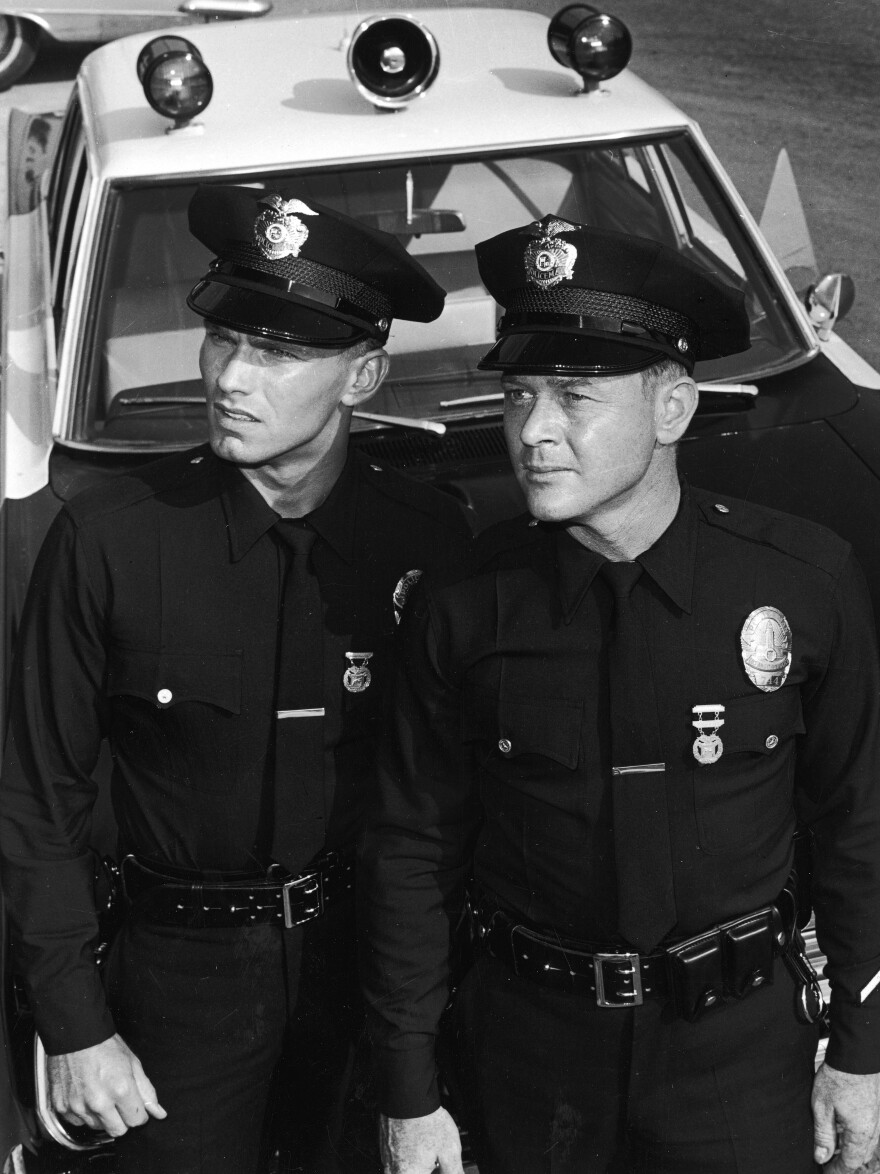 Martin Milner (right) died Sunday at age 83. He's seen here with co-star Kent McCord on the set of their TV series <em>Adam-12</em> in 1969.