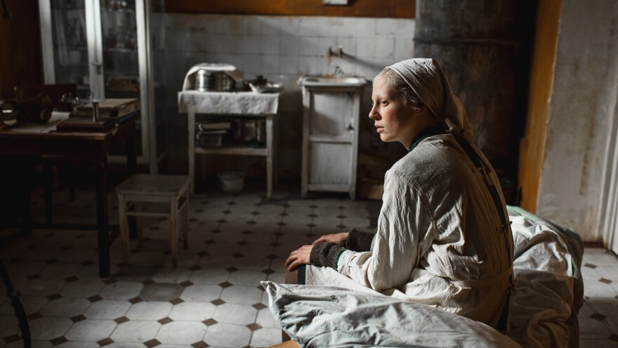 Iya (Viktoria Miroshnichenko) looks on in the grim but ultimately warm-hearted <em>Beanpole.</em>