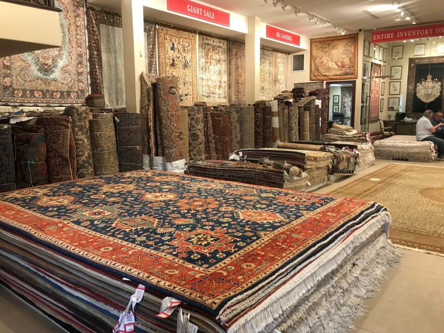 Helmi's rugs range from $1,000 up to $500,000, but his inventory is shrinking and he's unable to refill it because of the sanctions against Iran.