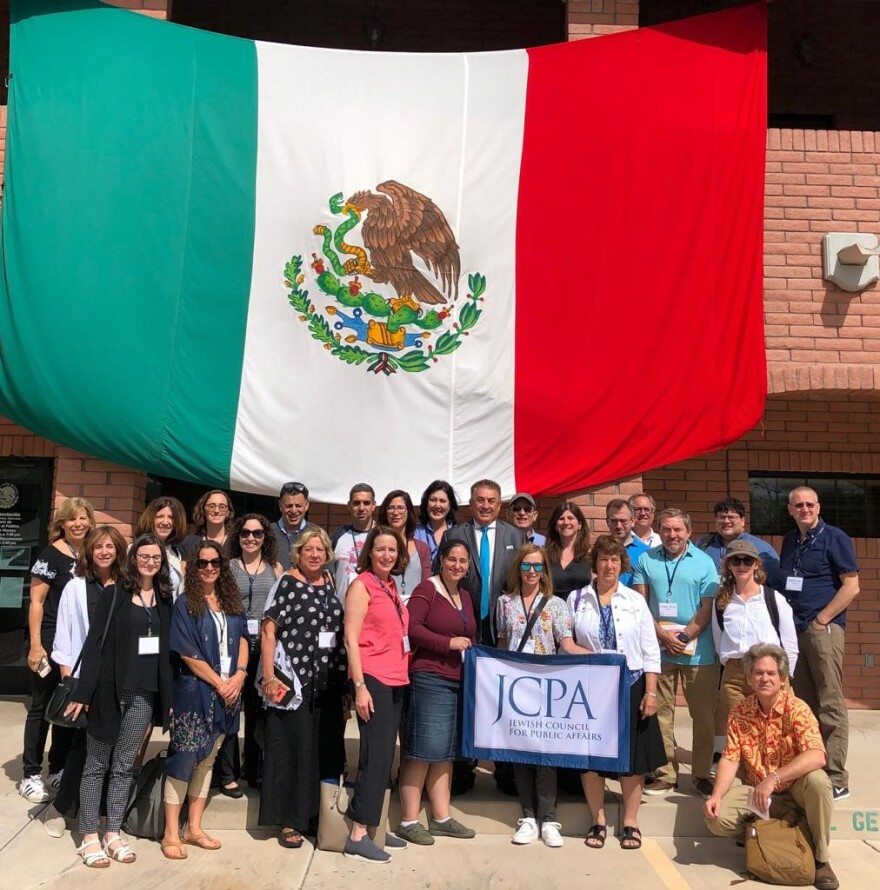A group of more than 20 Jewish organization leaders from around the country, including three from St. Louis pose with in the Mexican Counsel General (at center) in Nogales, Arizona in Sept. 2019.