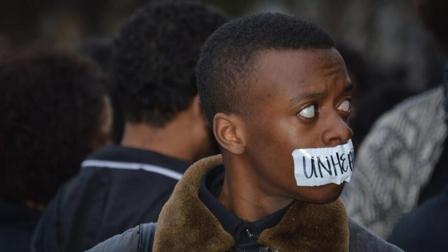A student protests racism on campus at the University of Oklahoma a day after a racist fraternity video surfaced in March.