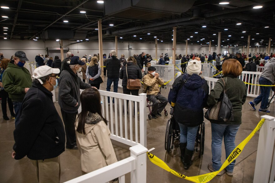 Long lines mostly comprised of seniors and their caretakers form during the first day of the mega vaccine center at Fair Park, in Dallas, on Jan. 11, 2021.