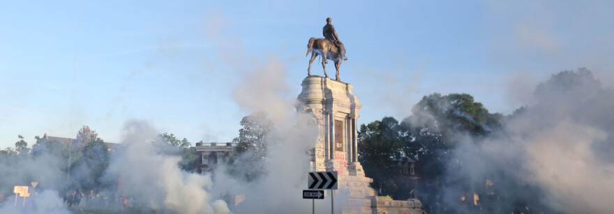 Tear gas clouds the air around the Monument Avenue statue of Confederate Gen. Robert. E. Lee on June 1, when Richmond police scattered hundreds of peaceful protesters by releasing tear gas and shooting pepper spray about 30 minutes before the 8 p.m. curfew was to go into effect.