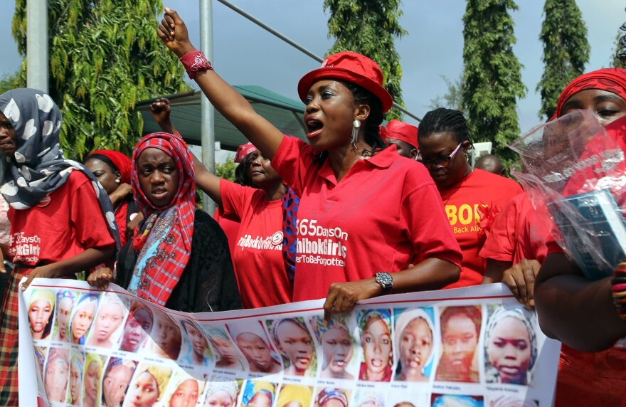 Members of the Bring Back Our Girls group urging the release of the Chibok schoolgirls kidnapped by Boko Haram militants march to meet with Nigeria's president in Abuja in July 2015.