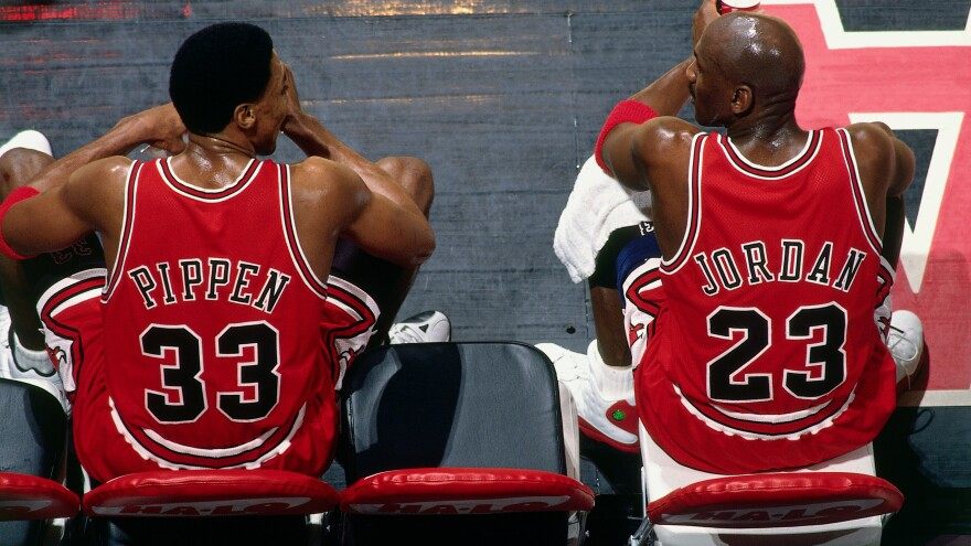 Scottie Pippen and Michael Jordan of the Chicago Bulls sit on the bench during a 1998 game.