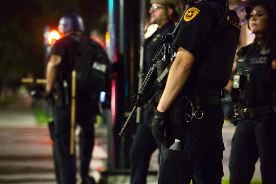 Photo of police standing outside at night