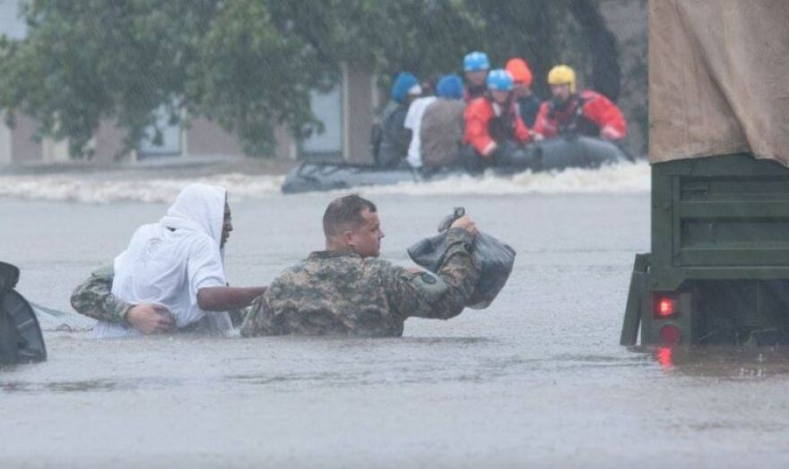 A member of the National Guard helps rescue storm victims in North Carolina after Hurricane Matthew.