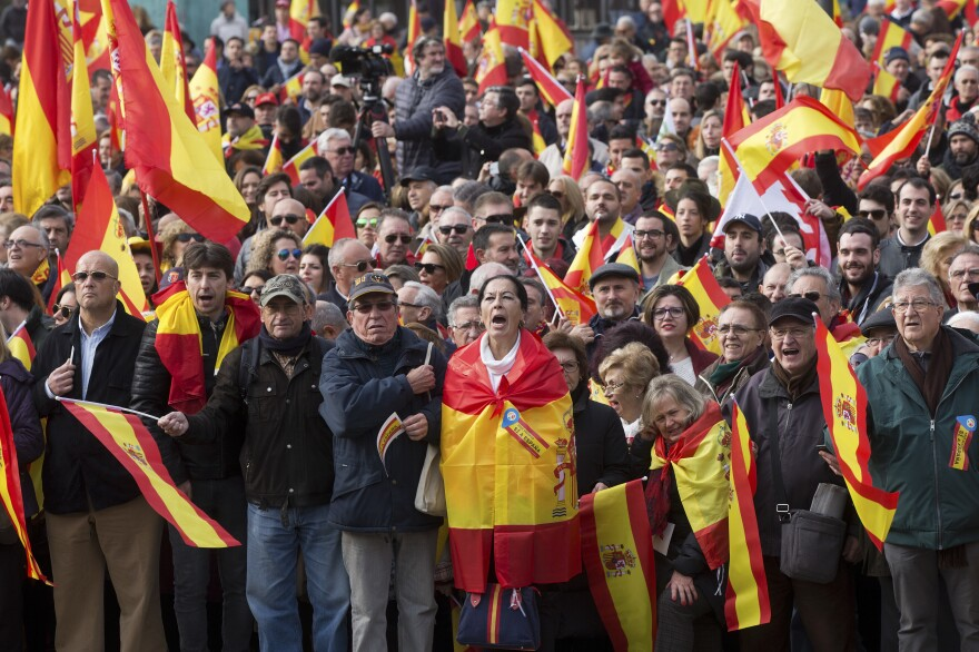 Supporters cheer on leaders of the right-wing Vox party in Madrid's Plaza de Colón on Dec. 1.