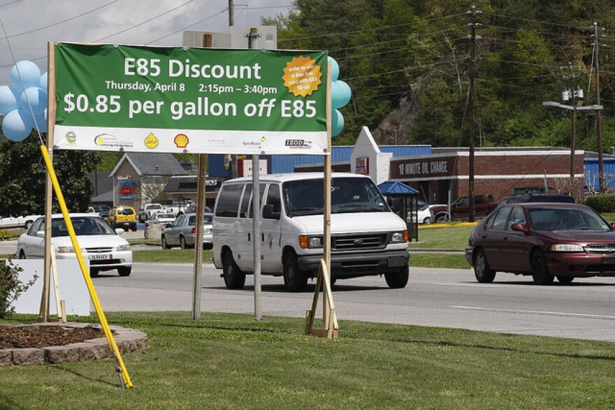 A sign for discounted E85 ethanol fuel. A requirement for alternative fuels in state vehicles has been removed from the Ohio Department of Transportation budget. gas cars