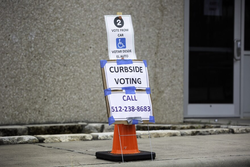 Curbside voting outside the Northwest Recreation Center voting location in Austin.