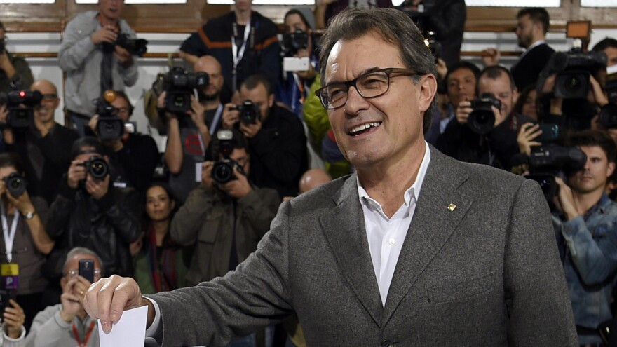 The president of Catalonia's regional government, Artur Mas, casts his ballot Sunday in a symbolic vote on whether to break away from Spain. Some 81 percent of voters opted for independence, but Spain says the vote was illegal and will not be recognized.