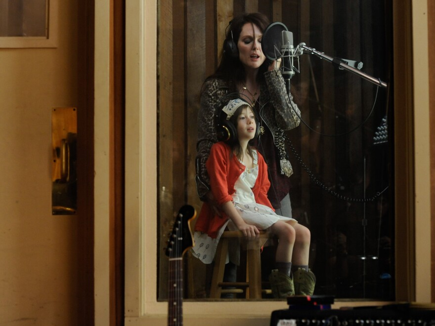Julianne Moore plays the hard-partying rock singer whose marital crisis kick-starts the film's plot.
