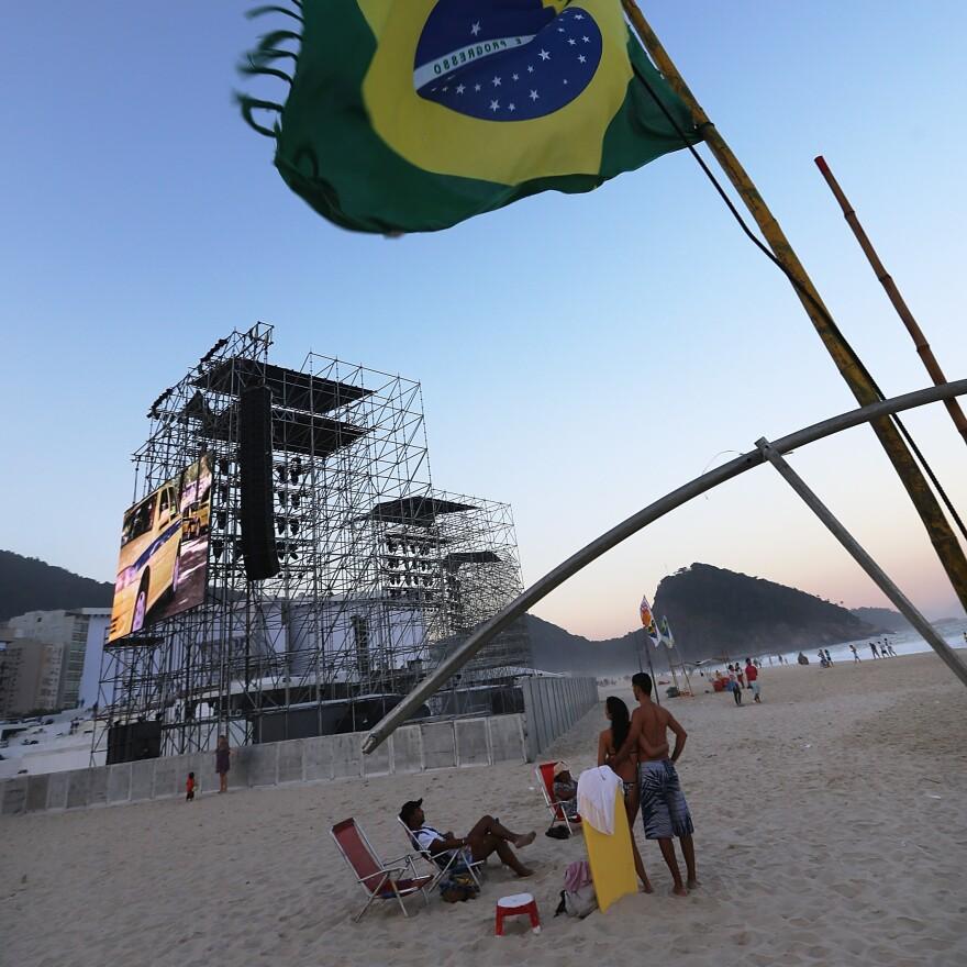 A Brazilian flag flies on Saturday near the podium which will receive Pope Francis on Copacabana Beach in Rio de Janeiro.