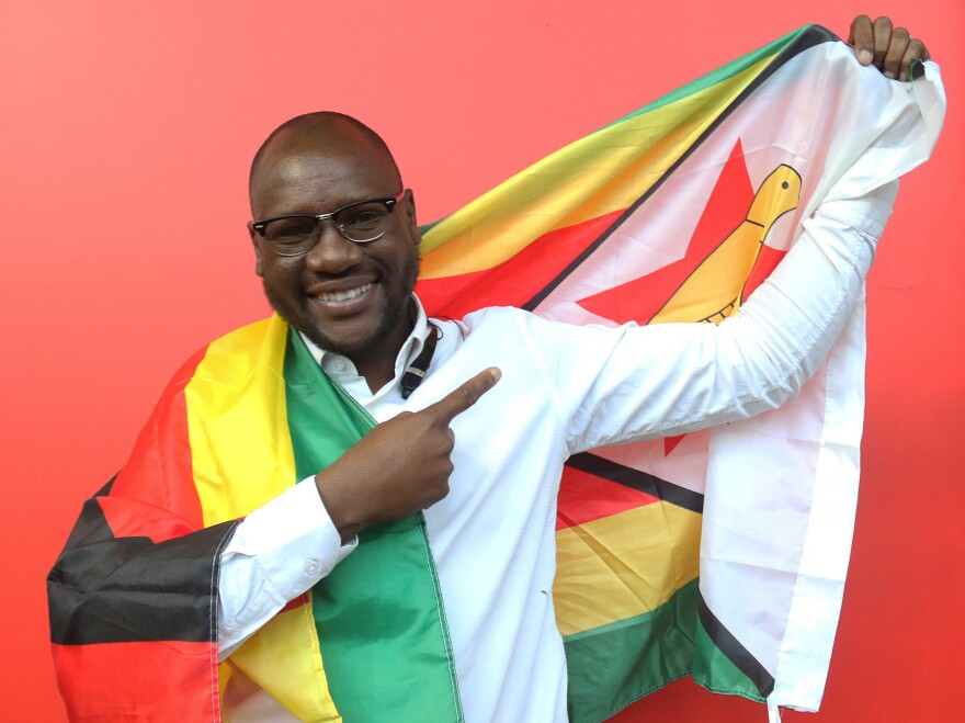 Evan Mawarire poses with a Zimbabwean flag in Harare, Zimbabwe, on May 3. He was arrested in July for inciting violence and disturbing the peace and left the country after he was released.