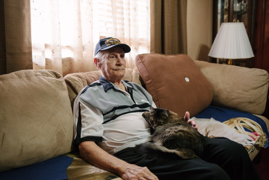 Harry Bollinger, 88, of Freeport, Pa., pauses as he talks about his recovery from mustard gas exposure as part of an experiment at the Naval Research Laboratory in Washington, D.C.
